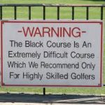 bethpage black warning sign